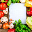 Open Notebook and Fresh Vegetables Background. Diet - Stock Photo