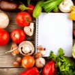 Open Notebook and Fresh Vegetables Background. Diet - Foto de Stock