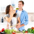 Happy Couple Cooking Together. Dieting. Healthy Food - 图库照片