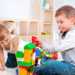 Children Boys playing with construction set on the floor - Stock Photo