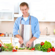 Young Man Cooking. Healthy Food — Stock Photo #20381635