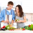 Happy Couple Cooking Together. Dieting. Healthy Food — Stock Photo #20381835