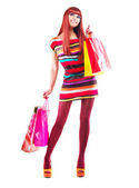 Fashion Shopping Girl. Woman with Shopping Bags over White — Stockfoto