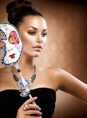 Masquerade. Beauty Girl with Carnival Mask — Stockfoto