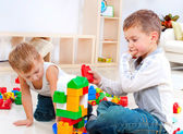 Children Boys playing with construction set on the floor — Photo