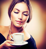 Beautiful Girl Drinking Tea or Coffee. Sepia Toned — Stock Photo
