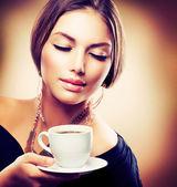 Beautiful Girl Drinking Tea or Coffee. Sepia Toned — Stock Photo