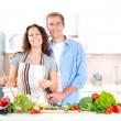 Happy Couple Cooking Together. Dieting. Healthy Food — Stock Photo #20391693