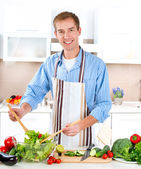 Young Man Cooking. Healthy Food - Vegetable Salad — Stock Photo