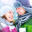 Happy Couple with Hot Drinks Outdoors. Winter Vacation — Stock Photo #21974951