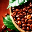 Coffee beans. Bowl of Aromatic Coffee close-up - Stok fotoğraf
