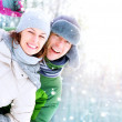 Happy Couple Having Fun Outdoors. Snow. Winter Vacation — Stock Photo #21975189
