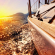 Yacht Sailing against sunset. Sailboat. Yachting. Sailing - Stock Photo