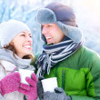 Happy Couple with Hot Drinks Outdoors. Winter Vacation — Stok fotoğraf