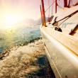 yacht sailing against sunset. sailboat. yachting — Stock Photo
