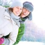 Happy Couple Having Fun Outdoors. Snow. Winter Vacation — Stock Photo #21976129