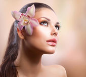 Beauty Portrait. Beautiful Stylish Girl with Orchid Flower — Stock Photo