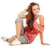 Tonårig flicka på en vit bakgrund — Stockfoto