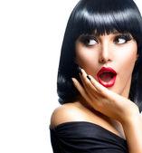 Krásná překvapený brunetka přes bílý — Stock fotografie