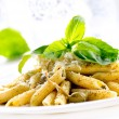 Penne Pasta with Pesto Sauce. Italian Cuisine - Stock Photo