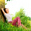 Stock Photo: Beautiful Young Woman Relaxing outdoors. Nature