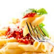 Pasta Penne with Bolognese Sauce, Basil and Parmesan — Stock Photo #24592925