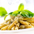 Royalty-Free Stock Photo: Penne Pasta with Pesto Sauce. Italian Cuisine