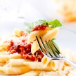 Pasta Penne with Bolognese Sauce, Basil and Parmesan — Stock Photo #24593163