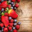 Berries on Wooden Background. Organic Berry over Wood — Stockfoto