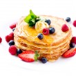 Pancake. Crepes With Berries. Pancakes stack isolated on White - Stock Photo
