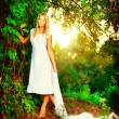 Beautiful girl in fairy forest near the river - Stock Photo