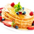 Pancake. Crepes With Berries. Pancakes stack isolated on White — Stock Photo #24593455