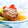Grilled Beef Steak Meat with Fried Potato, Asparagus, Tomatoes — Stock Photo #24593527