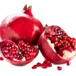 Pomegranates isolated on a White Background. Organic Bio fruits - Stock Photo