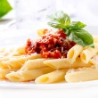Pasta Penne with Bolognese Sauce, Basil and Parmesan — Stock Photo #24593705