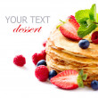 Pancake. Crepes With Berries. Pancakes stack isolated on a White - Stock Photo