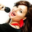 Beautiful Singing Girl. Beauty Woman with Microphone over White - Stock Photo