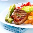 Grilled Beef Steak Meat with Fried Potato, Asparagus, Tomatoes — Stock Photo #24594177