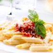 Pasta Penne with Bolognese Sauce, Basil and Parmesan — Stock Photo #24594217
