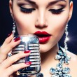 Singing Woman with Retro Microphone. Vintage Style — Stock Photo
