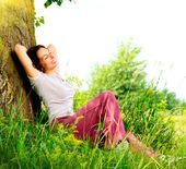 Beautiful Young Woman Relaxing outdoors. Nature — Foto de Stock