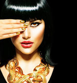Beauty Brunette Egyptian Woman.Golden Accessories — Photo
