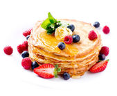 Pancake. Crepes With Berries. Pancakes stack isolated on White — Stock Photo