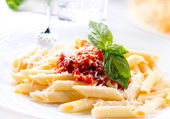 Pasta Penne with Bolognese Sauce, Basil and Parmesan — Stock Photo