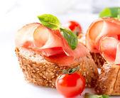 Jamon. Slices of Bread with Spanish Serrano Ham Served as Tapas — Stock Photo