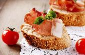 Jamon. Slices of Bread with Spanish Serrano Ham. Prosciutto — Stock Photo