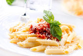 Pasta Penne with Bolognese Sauce, Basil and Parmesan — Photo