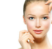 Beautiful Young Woman with Fresh Clean Skin touching her Face — Stock Photo