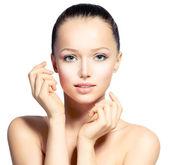 Beautiful Young Woman with Fresh Clean Skin touching her Face — Foto de Stock