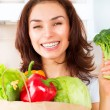 Happy Young Woman with vegetables in shopping bag. Diet Concept — Stock Photo #29983703